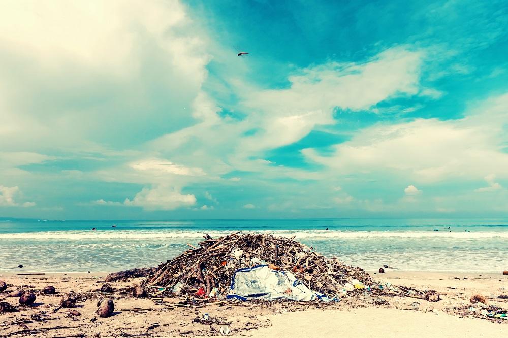 pile of trash on tropical beach
