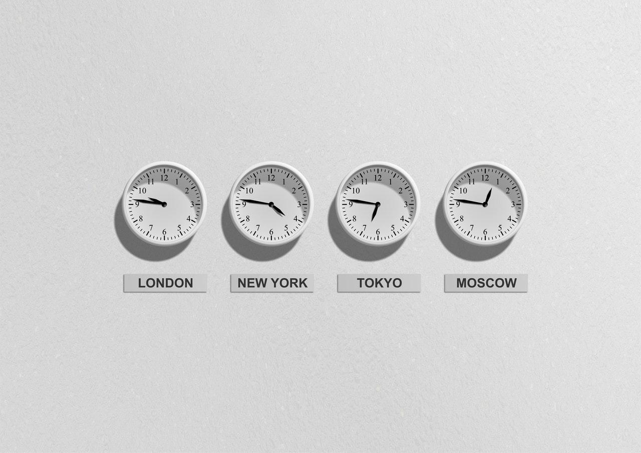 White clocks on a white wall