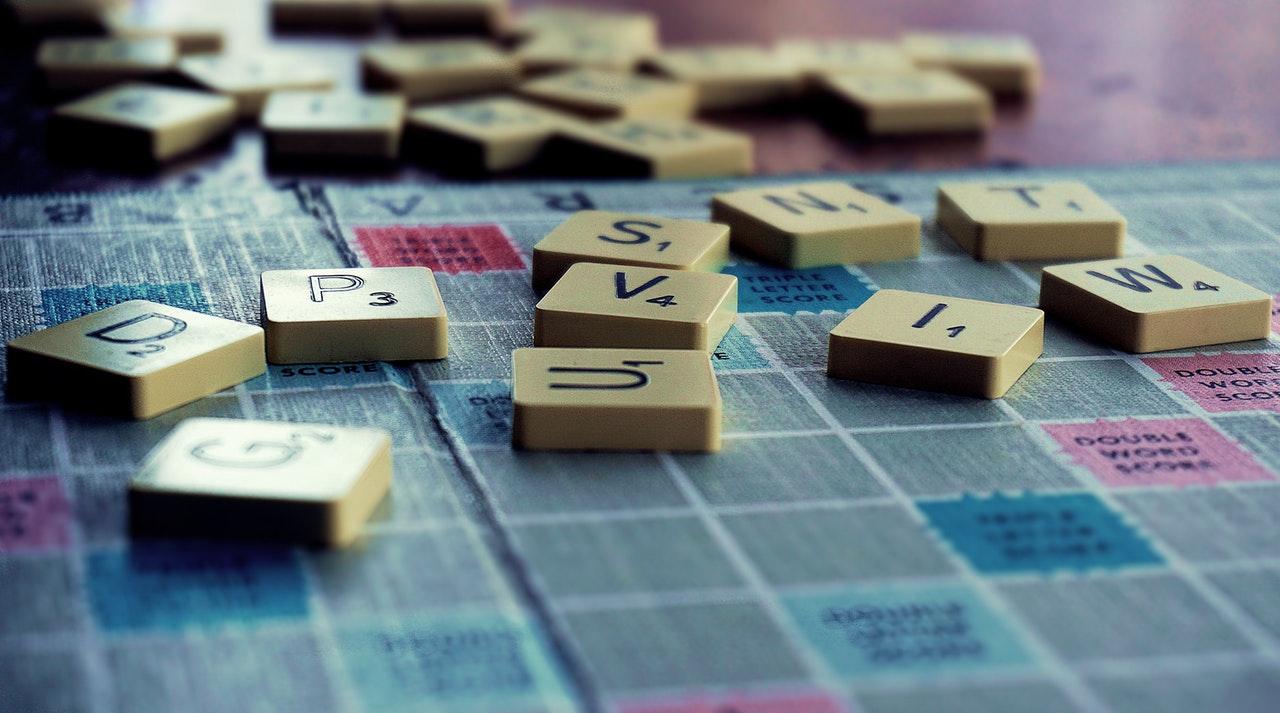 Scrabble pieces on a blue board