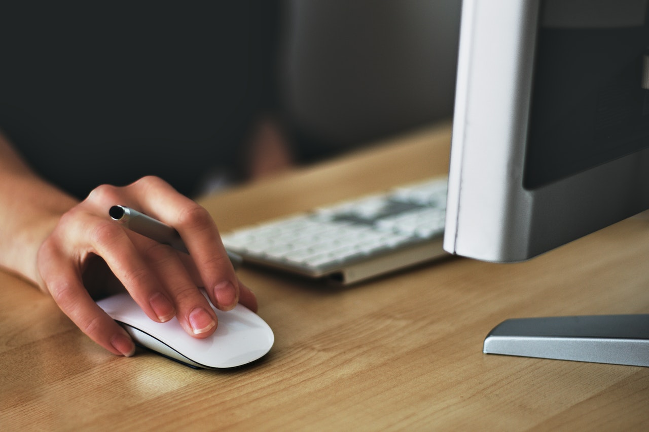 A person using a computer mouse