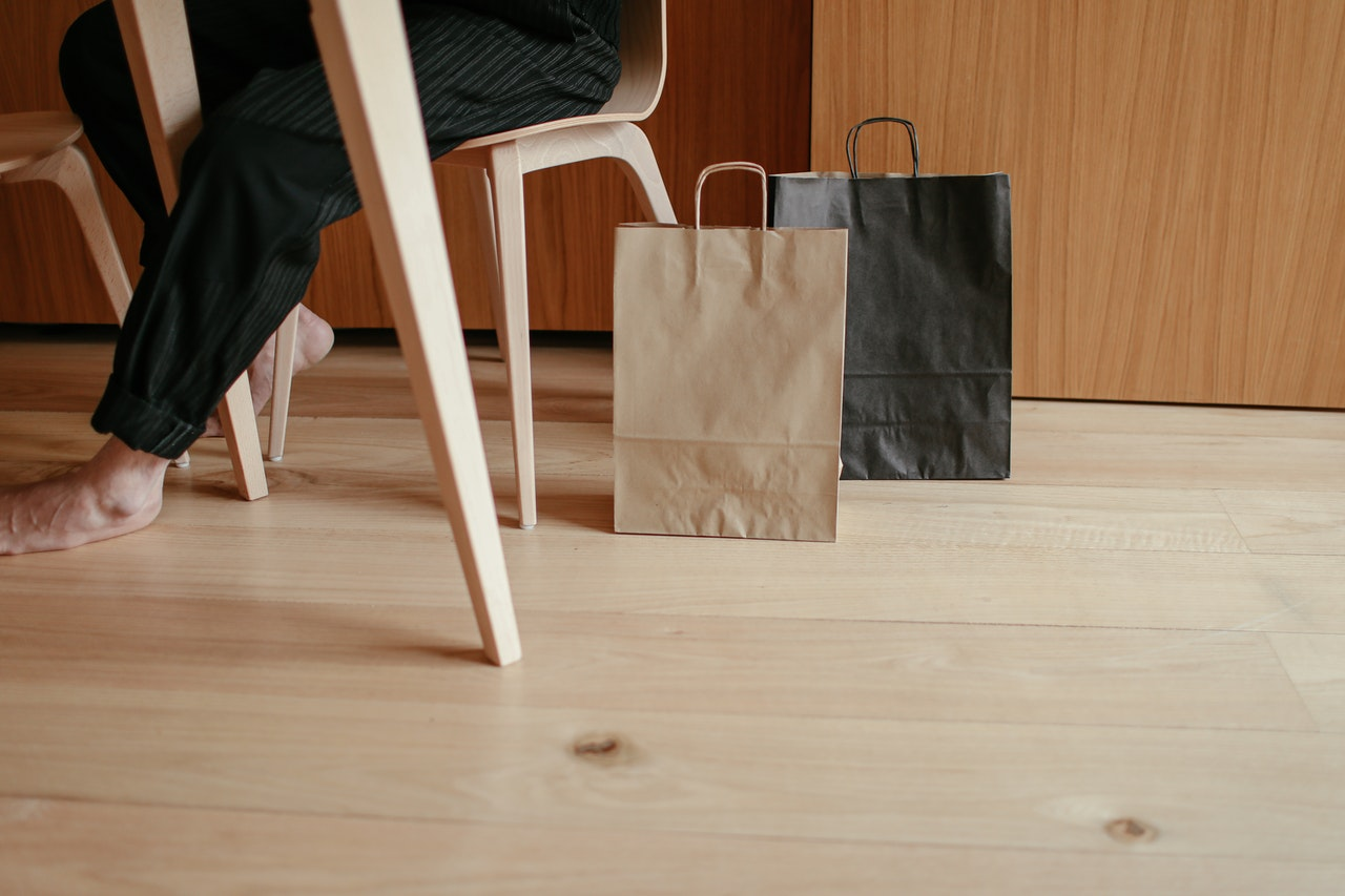 Shopping bags on the floor by a table