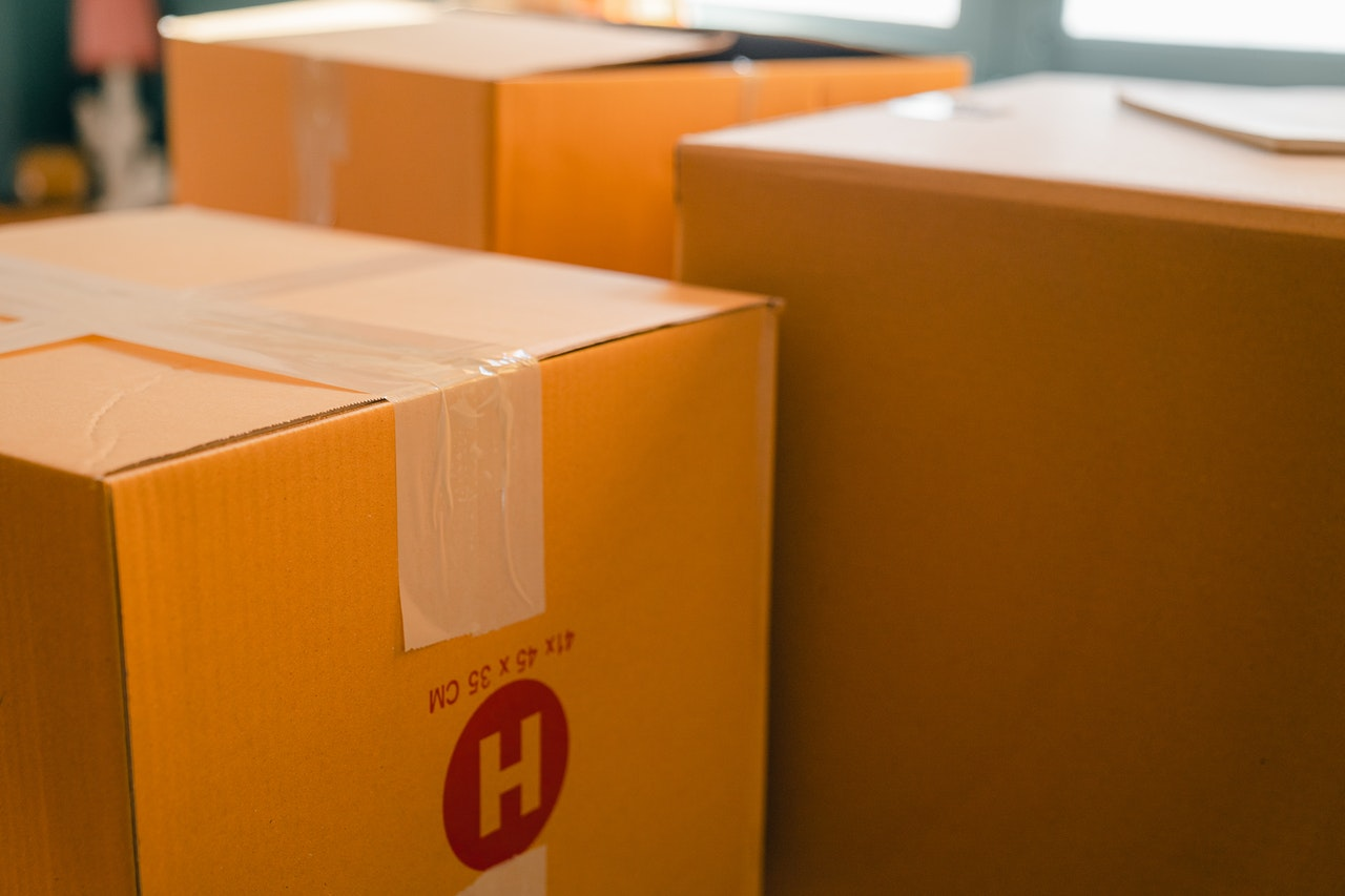 Cardboard boxes inside under yellow light